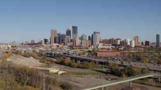DX0001_002167 - 5.7K stock footage aerial video flyby and away from the skyline of Downtown Minneapolis, Minnesota, seen from freeway