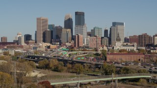 DX0001_002176 - 5.7K stock footage aerial video flyby I-394 freeway with a view of the city skyline, Downtown Minneapolis, Minnesota