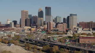 DX0001_002178 - 5.7K stock footage aerial video of passing the I-394 freeway and the city skyline, Downtown Minneapolis, Minnesota