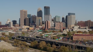 DX0001_002179 - 5.7K stock footage aerial video descend by the I-394 freeway and the city skyline, Downtown Minneapolis, Minnesota