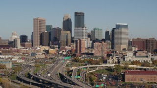 DX0001_002182 - 5.7K stock footage aerial video slowly flying by the freeway and the city skyline, Downtown Minneapolis, Minnesota