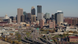 DX0001_002184 - 5.7K stock footage aerial video of passing by the city skyline behind the I-394 freeway, Downtown Minneapolis, Minnesota