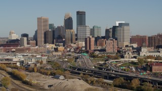 DX0001_002186 - 5.7K stock footage aerial video flyby the city skyline behind the I-394 freeway, Downtown Minneapolis, Minnesota
