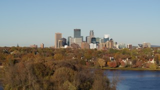 DX0001_002188 - 5.7K stock footage aerial video ascend from lake for wide view of the city's skyline, Downtown Minneapolis, Minnesota