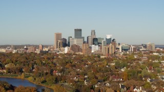 DX0001_002189 - 5.7K stock footage aerial video of the city's skyline seen from lakefront homes, Downtown Minneapolis, Minnesota