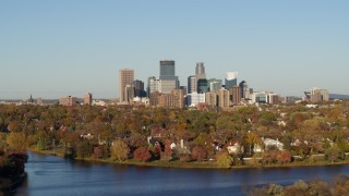 DX0001_002190 - 5.7K stock footage aerial video of the city's skyline seen while flying by lakefront homes, Downtown Minneapolis, Minnesota