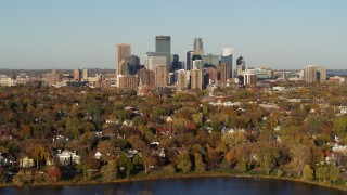 DX0001_002196 - 5.7K stock footage aerial video a wide view of the city's skyline seen from houses by the lake, Downtown Minneapolis, Minnesota
