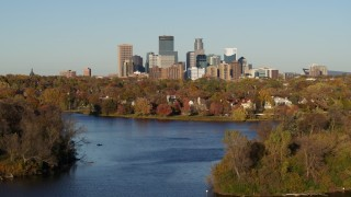 DX0001_002198 - 5.7K stock footage aerial video ascend from Lake of the Isles for a view of the downtown skyline, Downtown Minneapolis, Minnesota