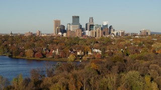DX0001_002199 - 5.7K stock footage aerial video descend toward Lake of the Isles with a view of the downtown skyline, Downtown Minneapolis, Minnesota
