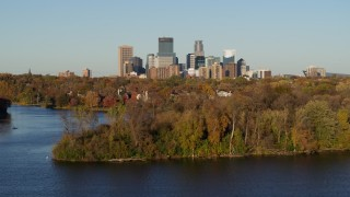 DX0001_002200 - 5.7K stock footage aerial video of the downtown skyline seen from the Lake of the Isles, Downtown Minneapolis, Minnesota
