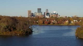 DX0001_002201 - 5.7K stock footage aerial video of the downtown skyline seen from homes by Lake of the Isles, Downtown Minneapolis, Minnesota