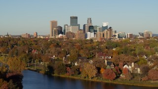 DX0001_002205 - 5.7K stock footage aerial video of the city skyline, seen from lakeside homes, Downtown Minneapolis, Minnesota