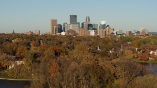 DX0001_002206 - 5.7K stock footage aerial video of reverse view of the city skyline, seen from Lake of the Isles, Downtown Minneapolis, Minnesota