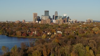 DX0001_002209 - 5.7K stock footage aerial video of the skyline of Downtown Minneapolis, Minnesota seen from homes by the lake