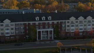 DX0001_002210 - 5.7K stock footage aerial video of an apartment building at sunset in Minneapolis, Minnesota