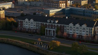 DX0001_002211 - 5.7K stock footage aerial video of flying away from an apartment building at sunset in Minneapolis, Minnesota