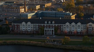 DX0001_002212 - 5.7K stock footage aerial video of flying past an apartment building at sunset in Minneapolis, Minnesota
