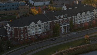 DX0001_002213 - 5.7K stock footage aerial video of passing an apartment building at sunset in Minneapolis, Minnesota