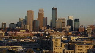 DX0001_002215 - 5.7K stock footage aerial video of a reverse view of the city's downtown skyline at sunset in Downtown Minneapolis, Minnesota