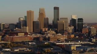 DX0001_002217 - 5.7K stock footage aerial video of passing by the city's downtown skyline at sunset in Downtown Minneapolis, Minnesota