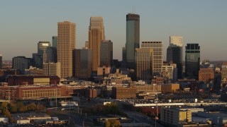 DX0001_002224 - 5.7K stock footage aerial video of a view of the city's downtown skyline at sunset in Downtown Minneapolis, Minnesota