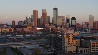 DX0001_002236 - 5.7K stock footage aerial video flyby the city's skyline at sunset during ascent, Downtown Minneapolis, Minnesota