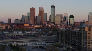 DX0001_002240 - 5.7K stock footage aerial video flyby city's skyline at sunset, seen from marketplace, Downtown Minneapolis, Minnesota