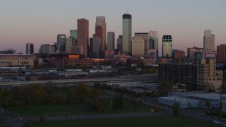 DX0001_002243 - 5.7K stock footage aerial video approach city's skyline at sunset from park, Downtown Minneapolis, Minnesota