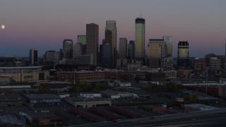 DX0001_002249 - 5.7K stock footage aerial video of the city's downtown skyline at twilight during descent, Downtown Minneapolis, Minnesota