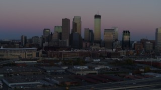 DX0001_002250 - 5.7K stock footage aerial video of the city's downtown skyline at twilight during ascent, Downtown Minneapolis, Minnesota