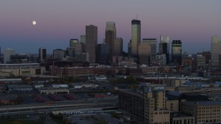 DX0001_002254 - 5.7K stock footage aerial video descend with market near the city's downtown skyline at twilight, Downtown Minneapolis, Minnesota