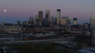 DX0001_002255 - 5.7K stock footage aerial video of the moon in the sky near the city's downtown skyline at twilight, Downtown Minneapolis, Minnesota