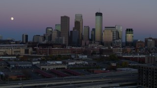 DX0001_002256 - 5.7K stock footage aerial video of the moon near the city's downtown skyline at twilight, Downtown Minneapolis, Minnesota