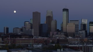 DX0001_002262 - 5.7K stock footage aerial video of flying by the city's skyline at twilight with moon in the sky, Downtown Minneapolis, Minnesota