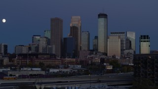 DX0001_002269 - 5.7K stock footage aerial video a view of skyscrapers in city skyline at twilight during descent, Downtown Minneapolis, Minnesota