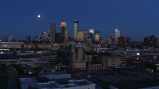 DX0001_002275 - 5.7K stock footage aerial video flyby market building with the moon above city skyline at twilight, Downtown Minneapolis, Minnesota