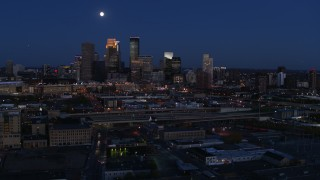 DX0001_002280 - 5.7K stock footage aerial video fly away from the moon above city's downtown skyline at twilight, Downtown Minneapolis, Minnesota