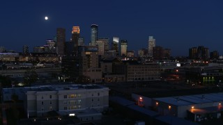 DX0001_002283 - 5.7K stock footage aerial video approach market building with moon above city's skyline at twilight, Downtown Minneapolis, Minnesota