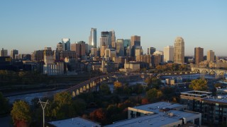 DX0001_002294 - 5.7K stock footage aerial video of the city skyline across the Mississippi River at sunrise, Downtown Minneapolis, Minnesota