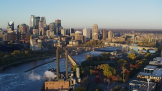 DX0001_002298 - 5.7K stock footage aerial video ascend to stationary view of skyline across the Mississippi River, Downtown Minneapolis, Minnesota