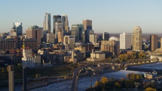 DX0001_002304 - 5.7K stock footage aerial video of a view of the city skyline across the Mississippi River at sunrise, Downtown Minneapolis, Minnesota