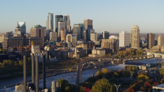 DX0001_002305 - 5.7K stock footage aerial video of a view of the city skyline across the river at sunrise during descent, Downtown Minneapolis, Minnesota