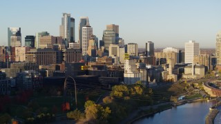 DX0001_002307 - 5.7K stock footage aerial video flyby the city skyline seen from the river at sunrise, Downtown Minneapolis, Minnesota