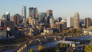 DX0001_002309 - 5.7K stock footage aerial video passing the city skyline seen from across the river at sunrise, Downtown Minneapolis, Minnesota