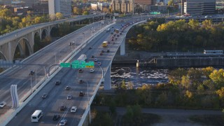 DX0001_002315 - 5.7K stock footage aerial video of slow traffic crossing a bridge at sunrise, Minneapolis, Minnesota