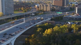 DX0001_002316 - 5.7K stock footage aerial video of slow traffic backing up on a bridge at sunrise, Minneapolis, Minnesota