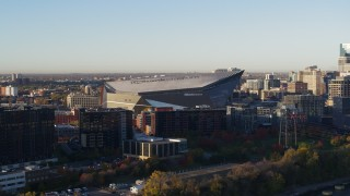 DX0001_002317 - 5.7K stock footage aerial video of US Bank Stadium at sunrise, Downtown Minneapolis, Minnesota