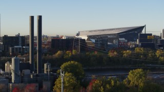 DX0001_002318 - 5.7K stock footage aerial video of US Bank Stadium at sunrise, seen from power plant, Downtown Minneapolis, Minnesota