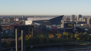 DX0001_002319 - 5.7K stock footage aerial video of US Bank Stadium on the other side of the river at sunrise, Downtown Minneapolis, Minnesota
