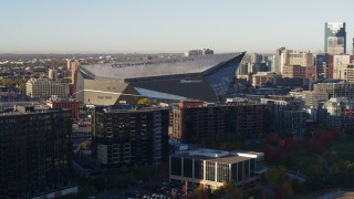DX0001_002321 - 5.7K stock footage aerial video of US Bank Stadium at sunrise while descending, Downtown Minneapolis, Minnesota